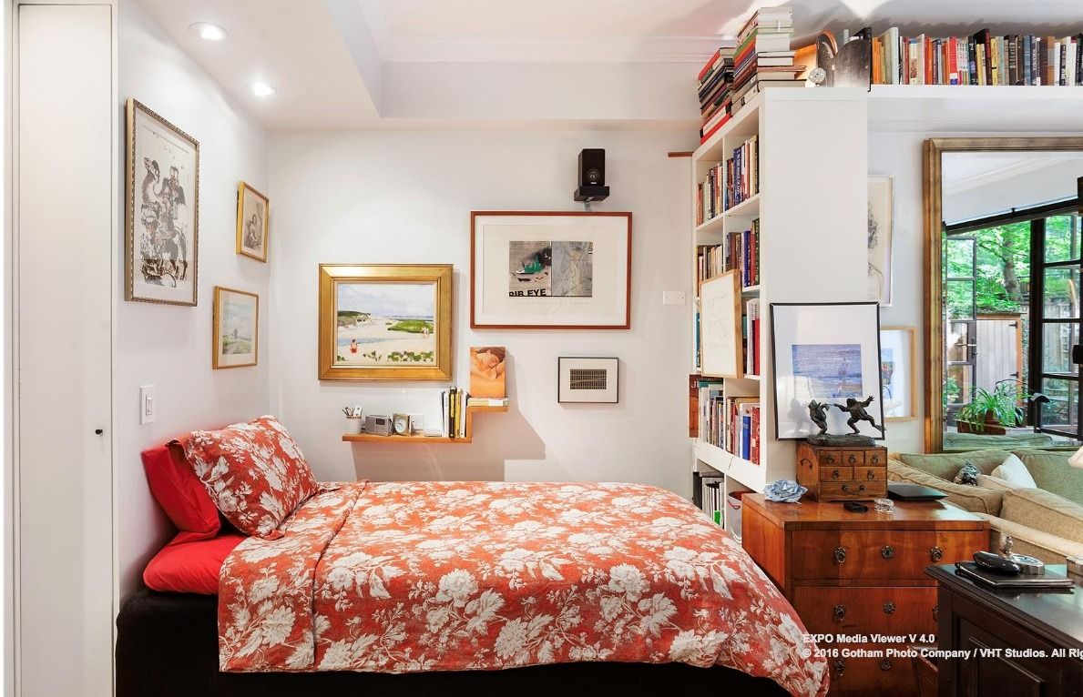 Greenwich village studio with wall of windows and private backyard a nook is lined with even more shelving and offers an ideal space to tuck a bed the apartment could also accommodate a queen sized murphy bed amipublicfo Images