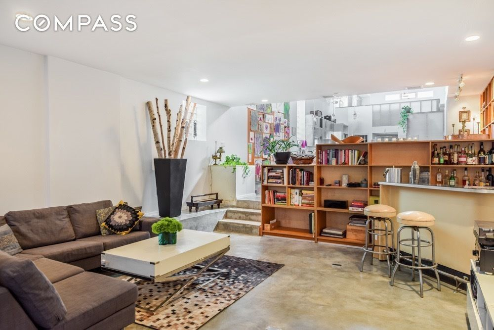 living room garage 2m garage conversion in bed stuy has a zen atrium and 11218