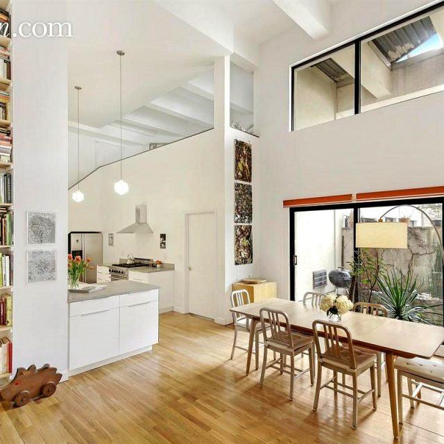 Park Slope co-op with custom bookshelves reaching 18 feet asks $1.65M