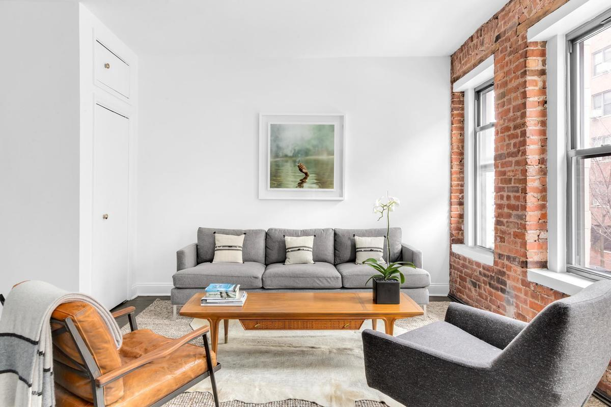 Flexible pad with plenty of exposed brick and a terrace asks $985K ...