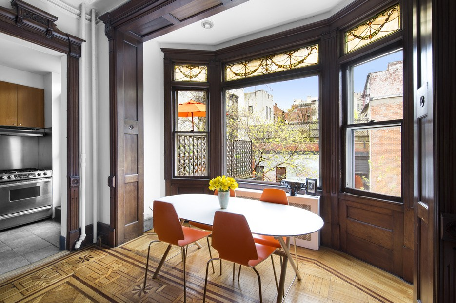 $1.095M duplex in a Park Slope brownstone boasts intricate stained glass and inlaid wood floors