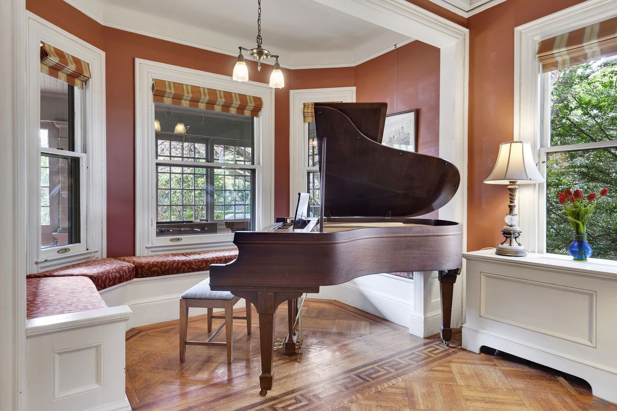 The Open Parlor Has Coffered Ceilings Extra Wide Windows A Wood Burning Fireplace And Built In Window Seating That Now Accommodates Grand Piano