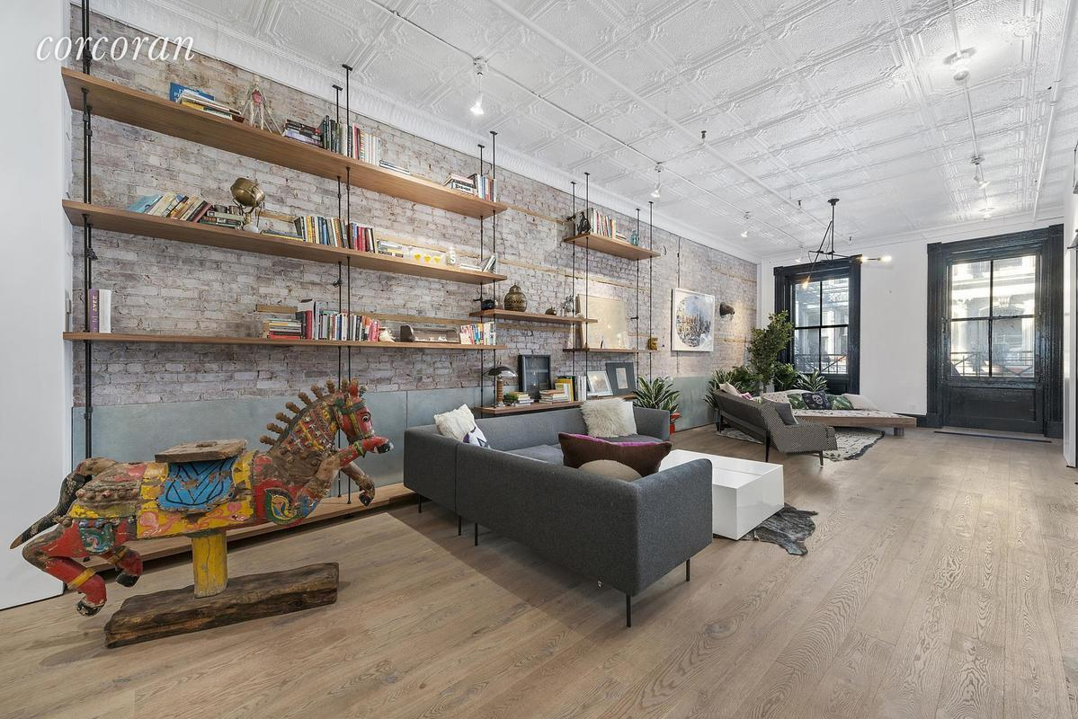 Direct Elevator Access Leads You Into The Bright Great Room, With Tin  Ceilings Soaring Just Above 11 Feet. The Lightly White Washed Exposed Brick  Was Set ...