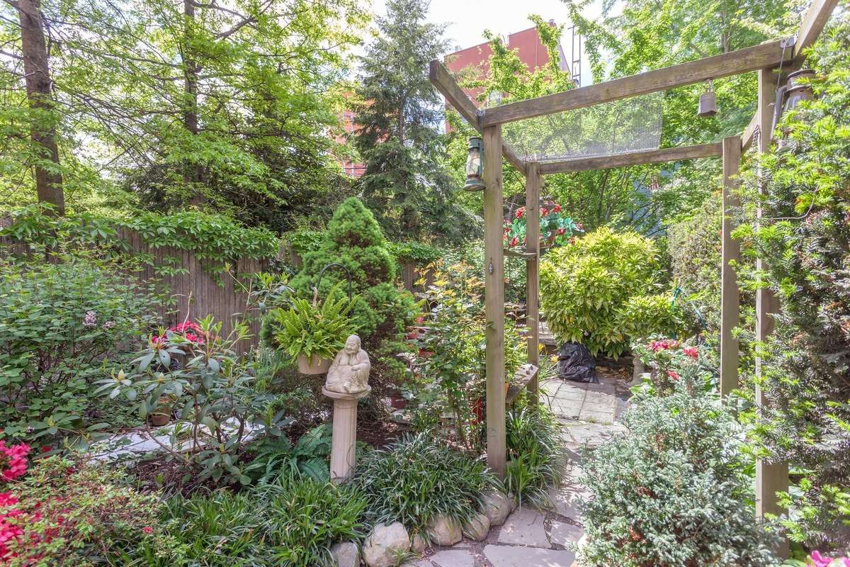 italianate townhouse with stunning sun room and lush backyard asks