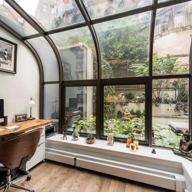 Greet the sun from your solarium or tech-friendly garden in this $1.7M East Village duplex