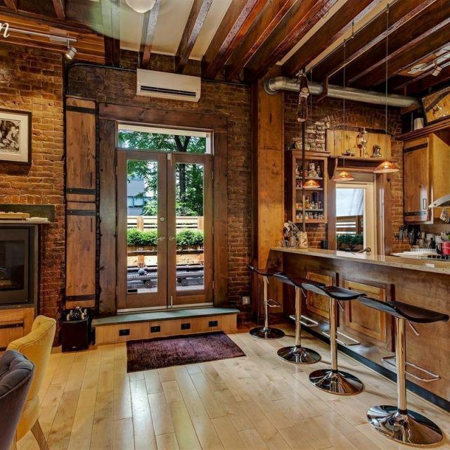 Rich wood and brick decorate this renovated East Village rental, for $13,995/month