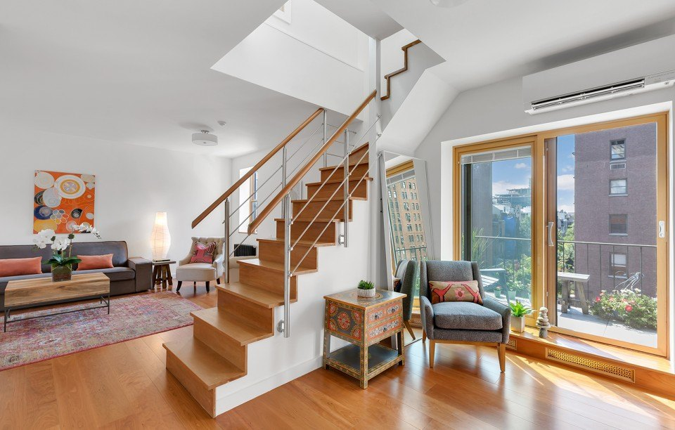 With two terraces and a fireplace, this $1.6M Chelsea duplex feels like a compact house