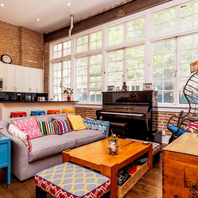 Colorful decor pops against massive brick walls at this $6,950/month Gramercy rental