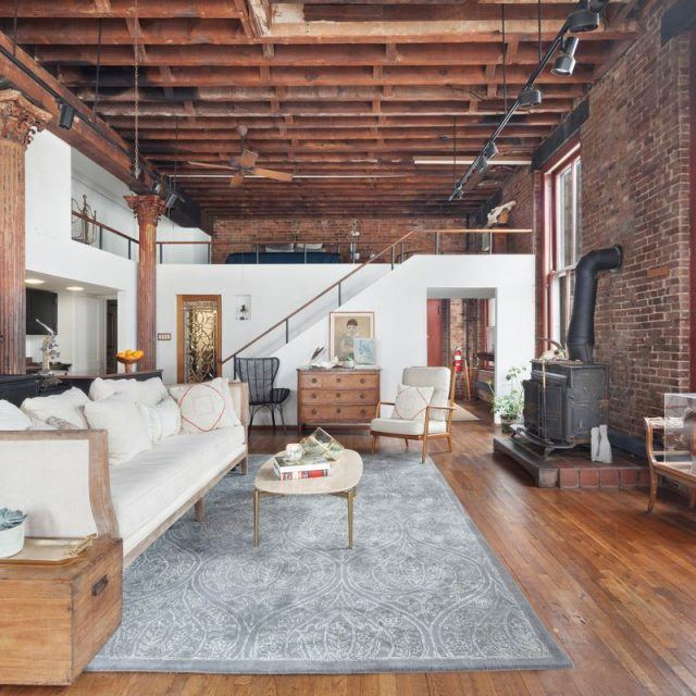 Rare and historic Dumbo triplex once owned by artist Caro Heller hits the market for $2M
