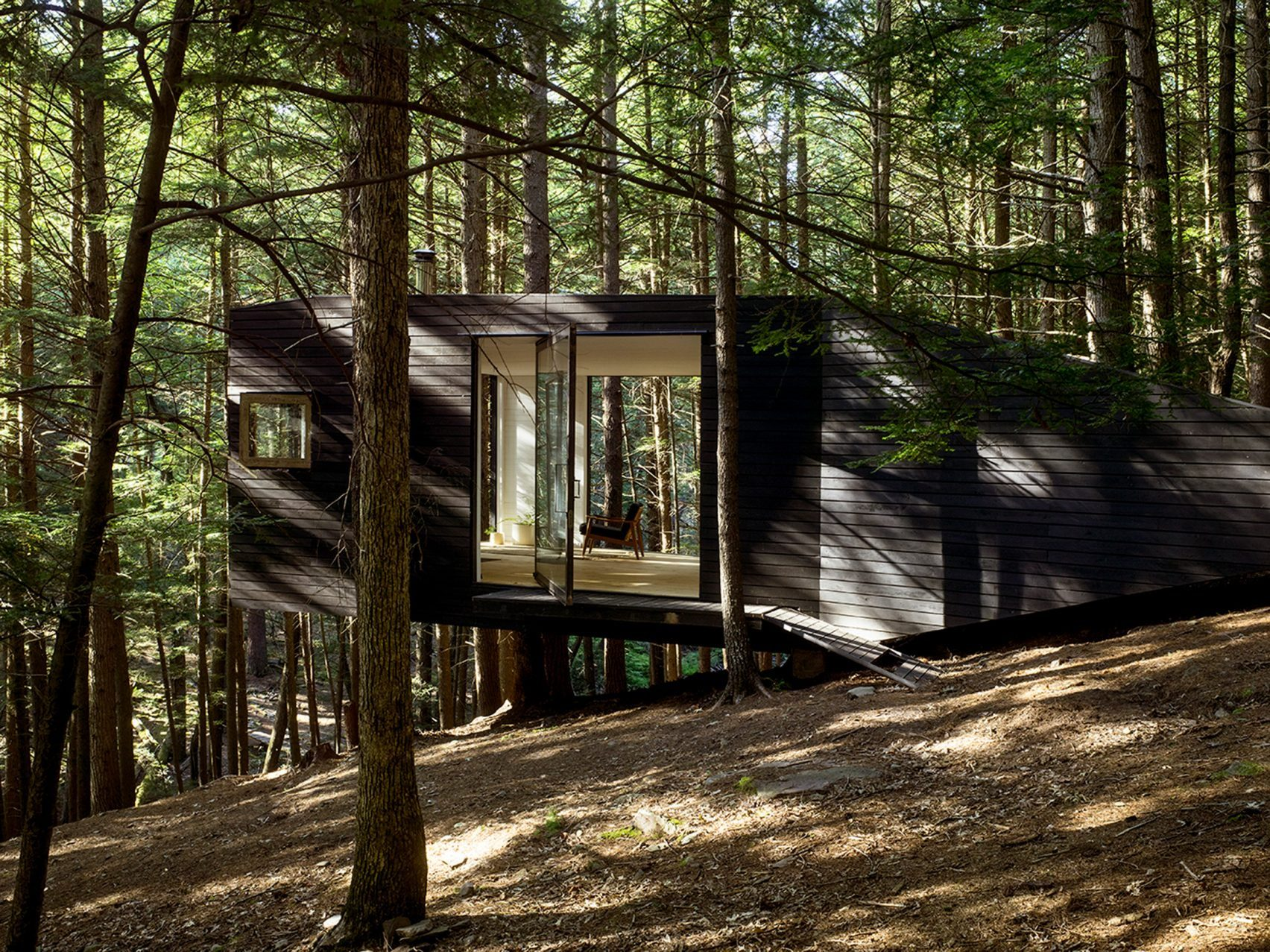 Single room treehouse in an upstate forest was constructed for New york cabin