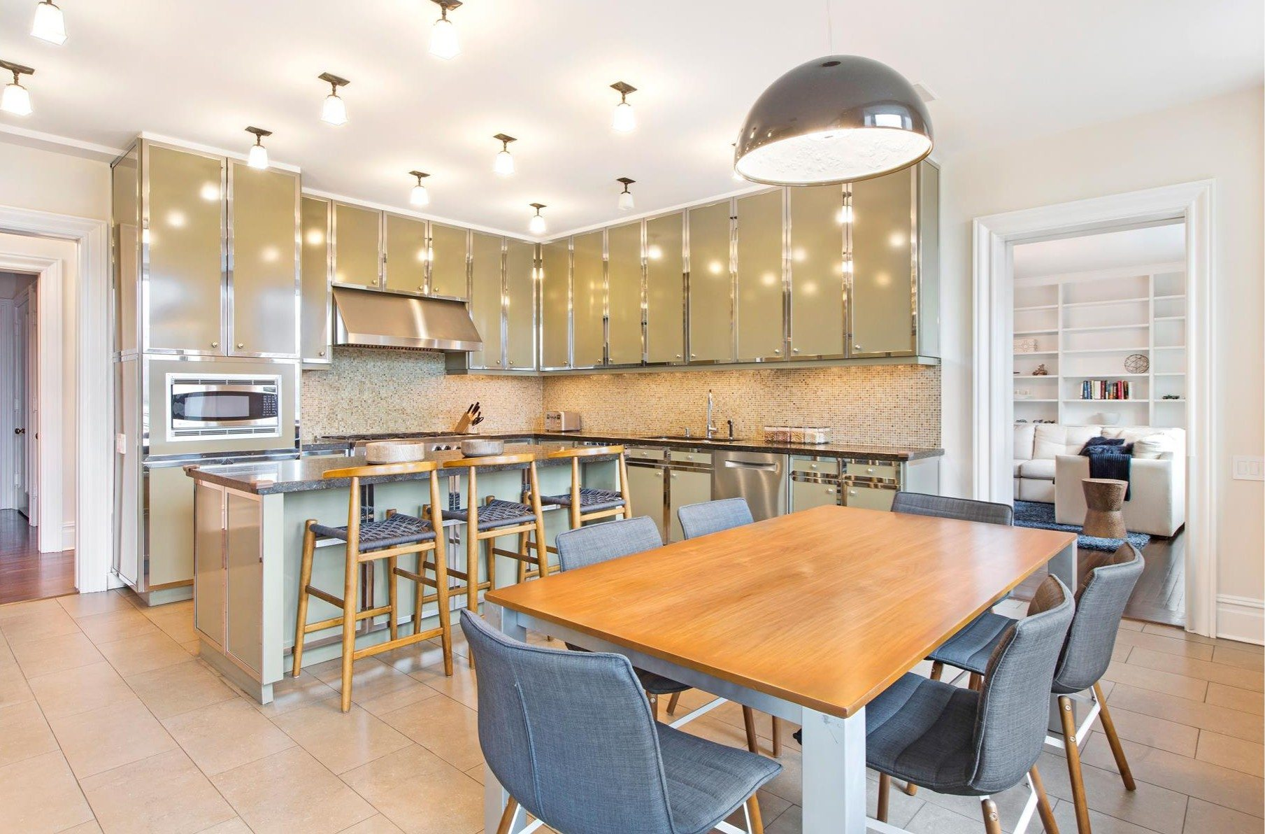The Eat In Kitchen Has Two Refrigerators, A Six Burner Viking Stove, Custom  Cabinets With Chrome Accents, And Honed Granite Counters.