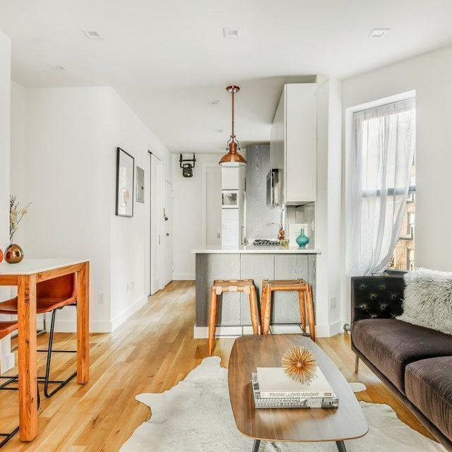$1M West Village condo looks chic with high ceilings and exposed brick
