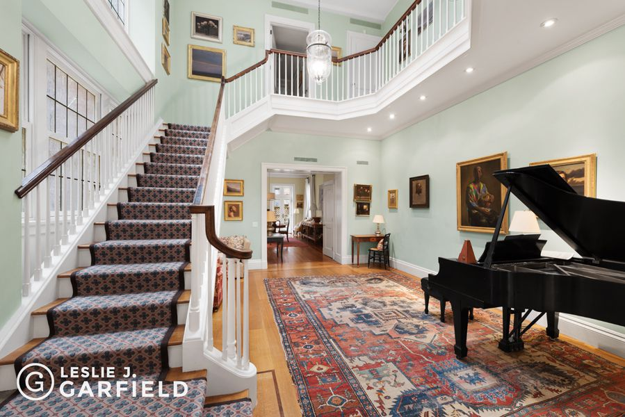 Upper East Side townhouse with an artistic pedigree, an artists' studio and a curb cut asks $19M