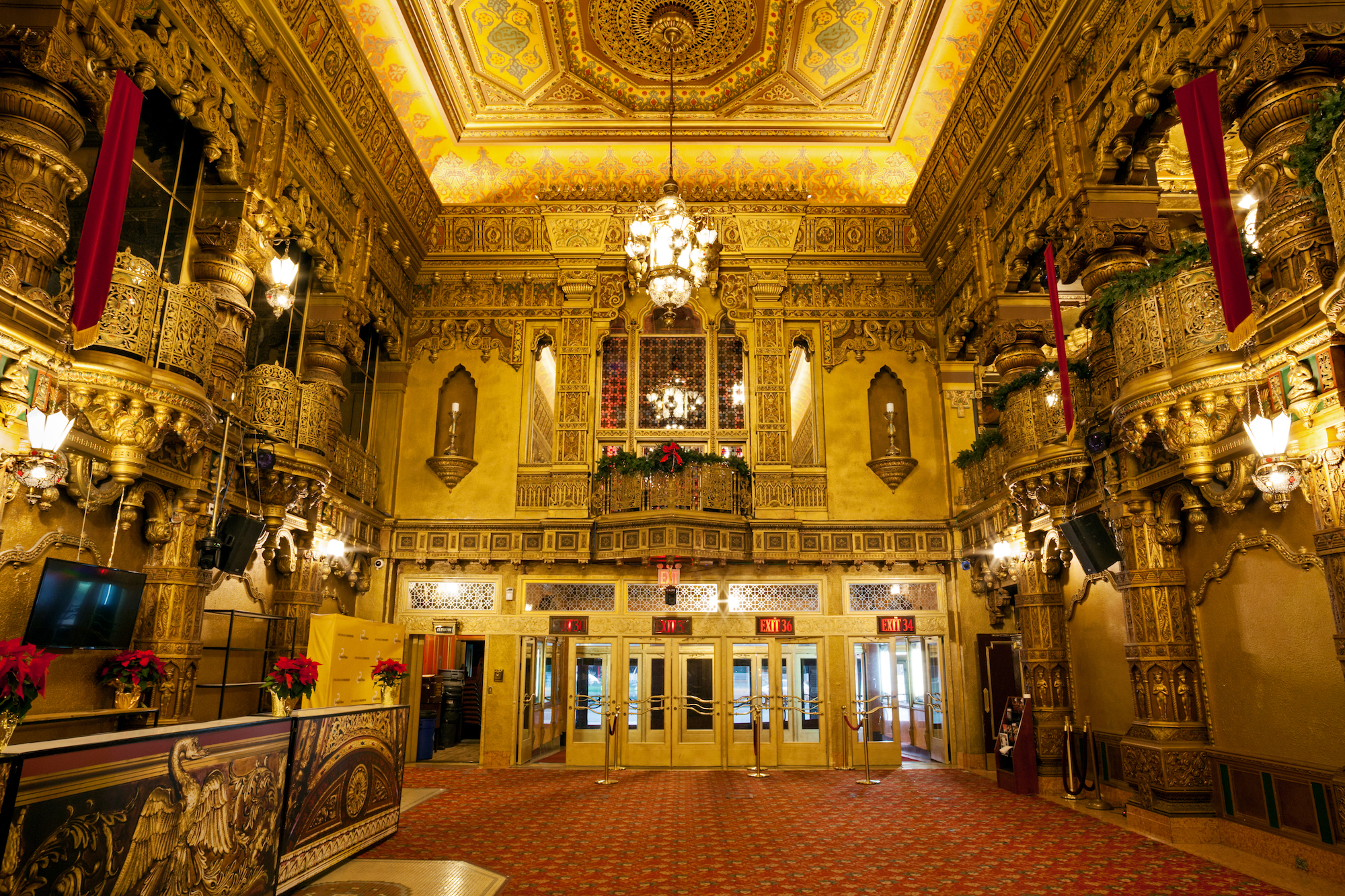 the chandeliers crank down for cleanings and to have their roughly 70 bulbs replaced