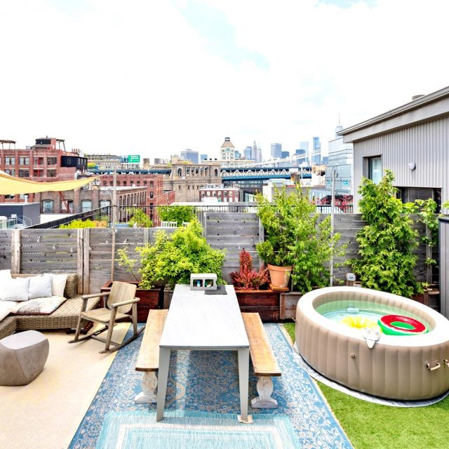 $7,000/month Dumbo triplex makes a splash with rustic details–and a rooftop beach