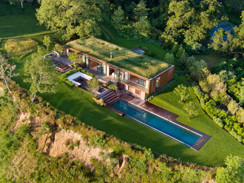 At this five-acre Hamptons getaway, a grass roof and infinity pool camouflage with the landscape