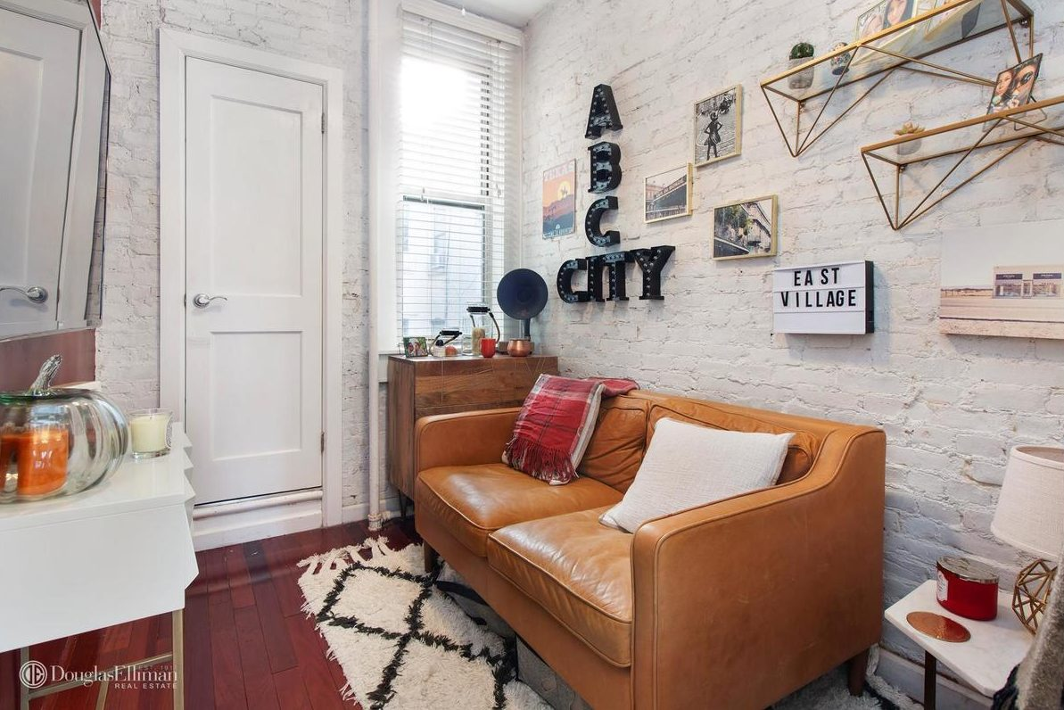 In total the apartment has five large windows nine and a half foot ceilings and all new appliances though it is a railroad layout the entrance is off