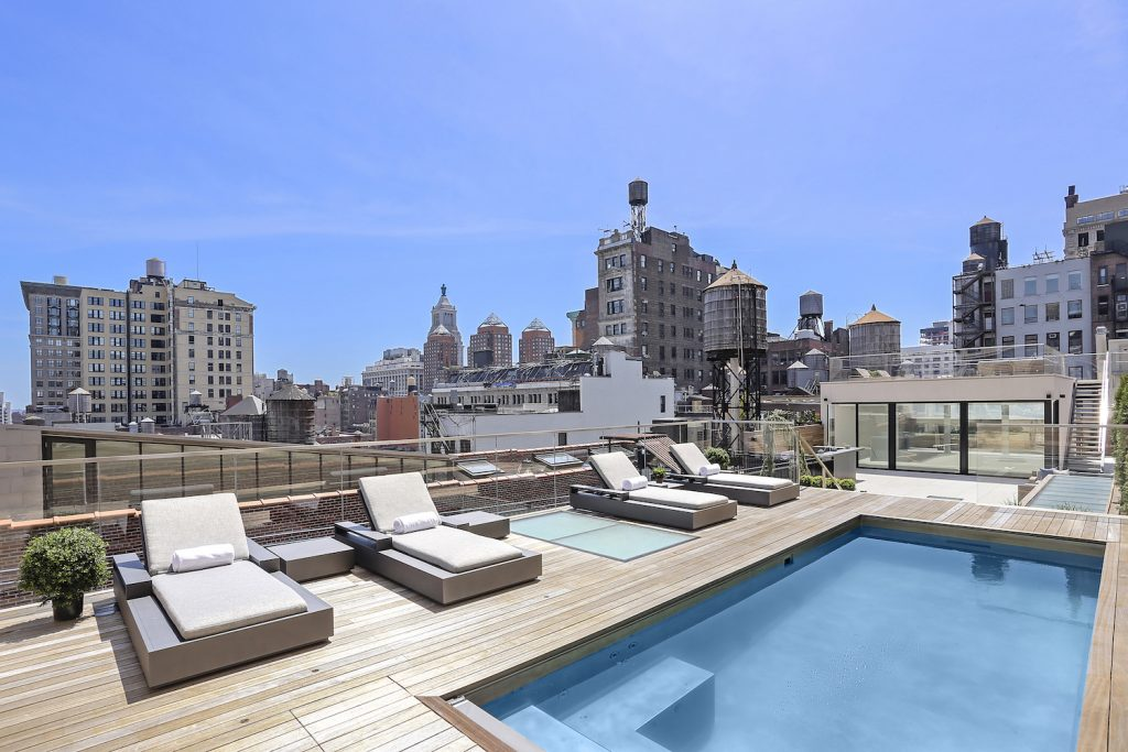 The massive roof deck at this $15.5M Flatiron penthouse has a 20-foot pool and full bar