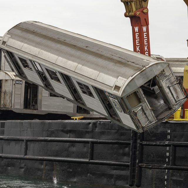 Photo exhibit shows 10 years of subway cars dropped in the Atlantic Ocean to become artificial reefs