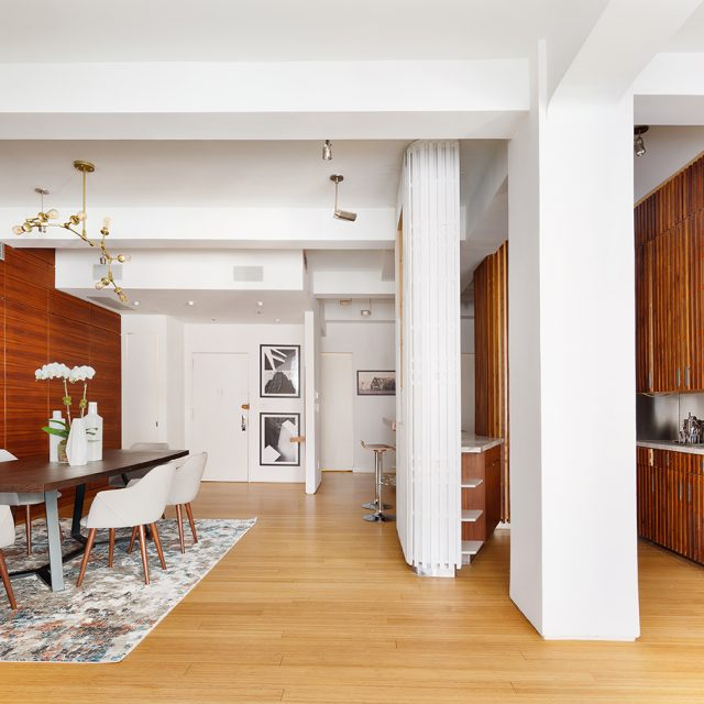 Walnut finishes throughout this $3.1M Nomad loft combine glamour and utility