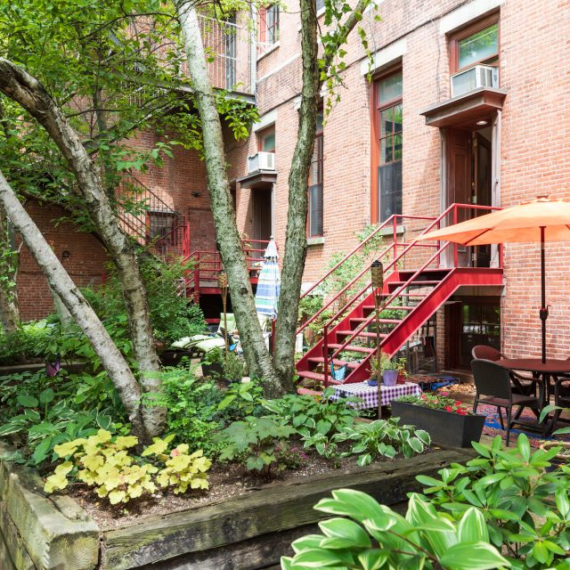 In a converted Cobble Hill school, this $1.5M co-op has three floors and a private patio