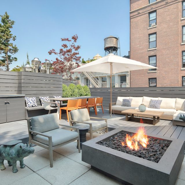 $6.8M Soho penthouse is a modern glass oasis with a roof deck and a fire pit