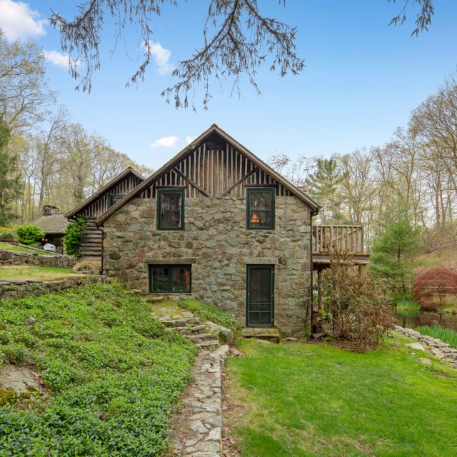 Every day could be a camping adventure at this $998K Connecticut log and stone country home