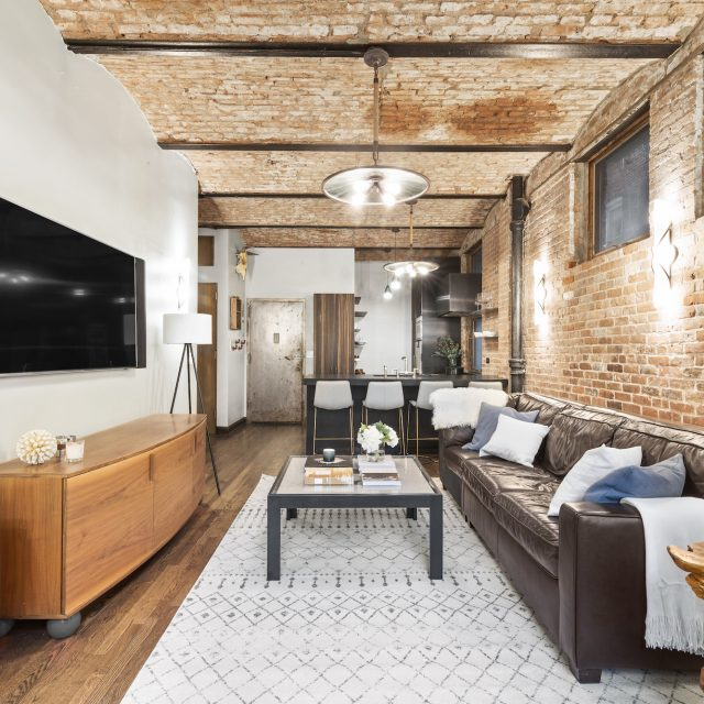 Asking $995K, this rustic West Village co-op has soaring brick barrel-vaulted ceilings