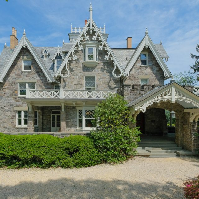 In Westchester, this $3.5M Gothic Revival home has 6 fireplaces, Tiffany windows, and NYC skyline views