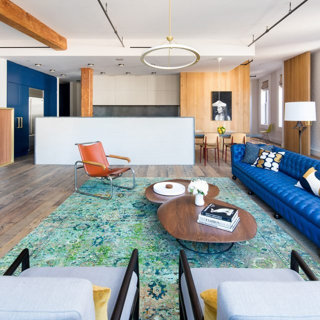 $20K/month Nolita loft is colorful, modern, and above a library
