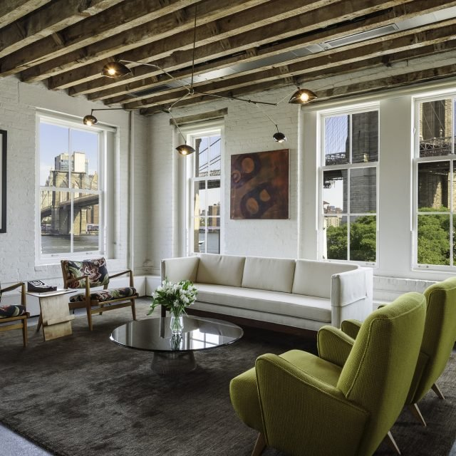 $3.25M waterfront loft in Brooklyn Heights has view of the Brooklyn Bridge and Statue of Liberty