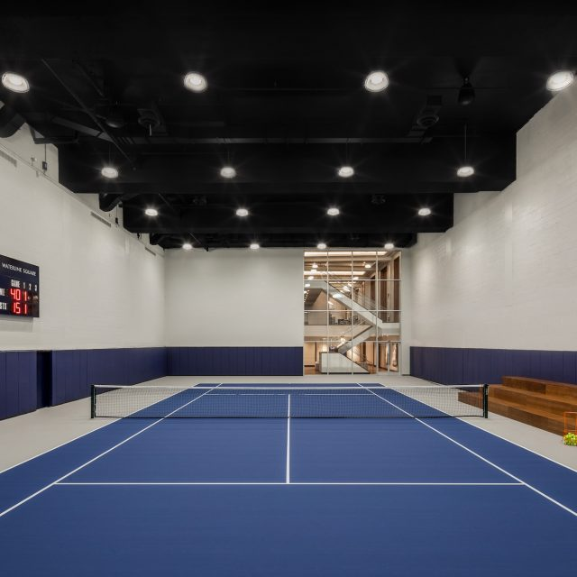 Waterline Square's amenities include an indoor skate park, full tennis court, and a rock-climbing wall
