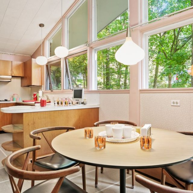 For $1.1M, a mid-century time capsule in Connecticut with pink accents and a retro bar