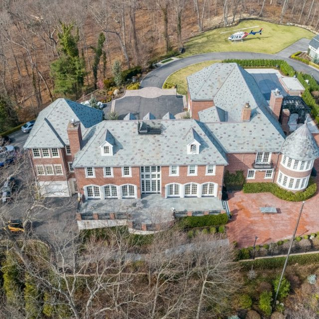 $7.9M hilltop brick mansion on Long Island has its own heliport