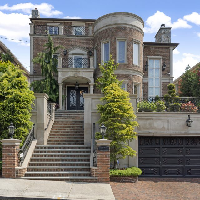 Grand Dyker Heights home has a heated pool, outdoor kitchen, and two-car garage for $6.2M