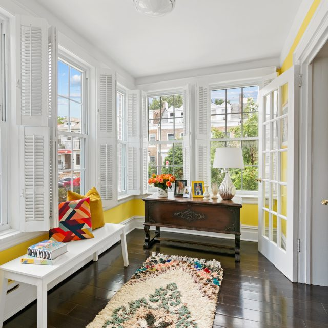 Beautiful Bay Ridge townhouse has 3 bedrooms, a 2-car garage, and a sun porch for $1.25M