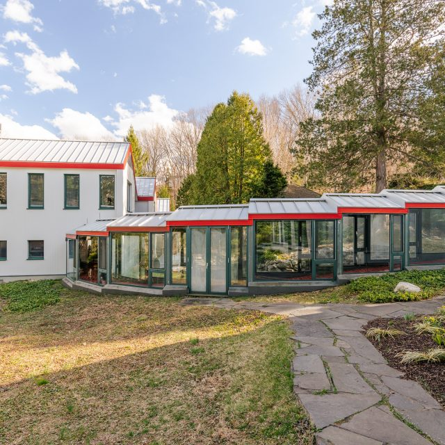 Designed by Paul Mayén, this $4.2M upstate oasis sits on 14 acres with a waterfall and indoor pool