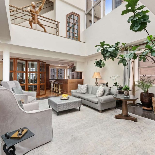 This $7.85M East Village penthouse has a 40-foot glass atrium and Tuscan-inspired terrace