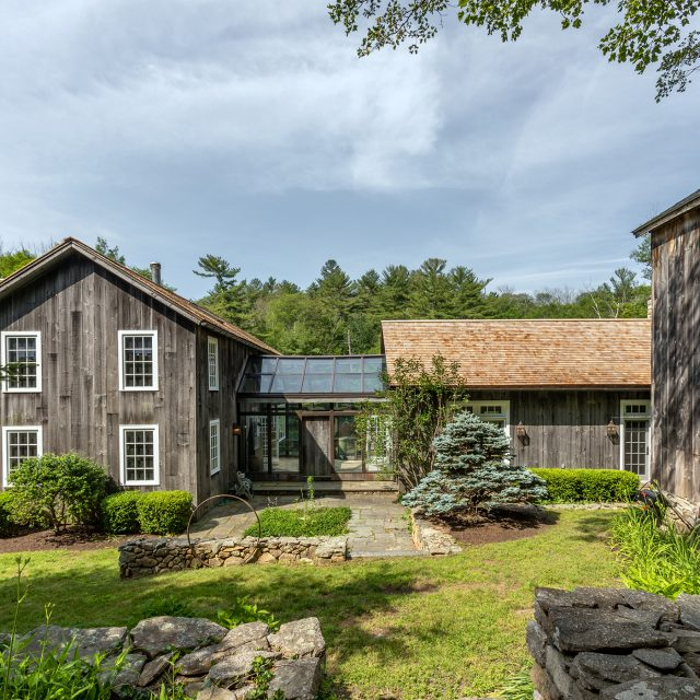 Contemporary Connecticut barn sits on 19 acres with views of the Catskills for $2.2M