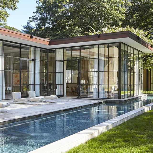 Architect Michael Haverland lists his modern glass house in East Hampton for $5M