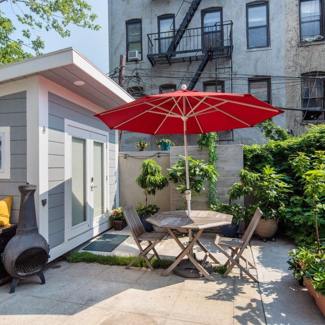 $1.4M Park Slope condo has 14-foot ceilings and a backyard gardening shed