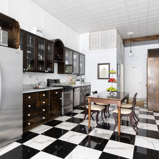 For $650K, this salon-style Midtown studio has a ritzy kitchen and Parisian vibes