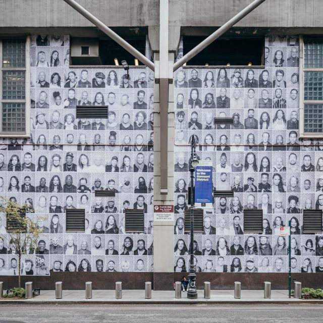 The faces of 1,200 New Yorkers now greet visitors outside of the Port Authority bus terminal